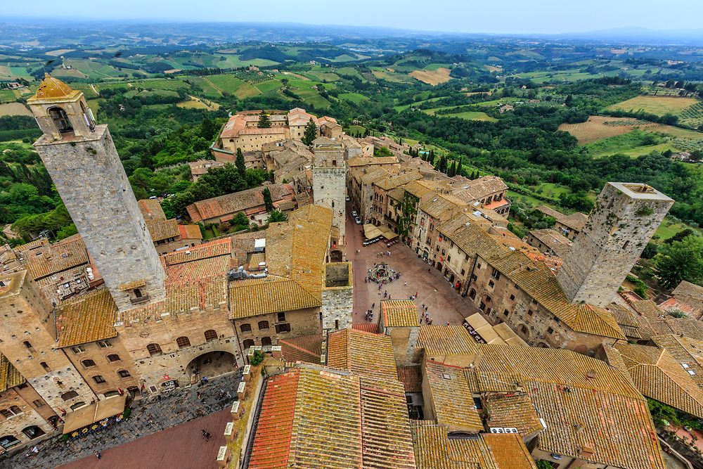 San Gimignano in Tuscany, Italy. The town was controlled by two major rival families - the Ardinghelli, Guelph sympathizers, and the Salvucci, who were Ghibellines - and was the scene of incessant conflicts between the two clans. As symbols of their wealth and power, 72 tower houses were built. Of these, 14 have survived.