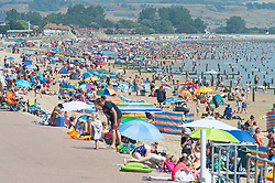 ©Licensed to London News Pictures 07/08/2020   Dymchurch, UK. Hundreds of sun worshippers on the beach at Dymchurch in Kent on the south coast. Scorching hot weather today in the UK as the heatwave weather looks set to continue into next week. Today could be one of the hottest on record if not the hottest. Photo credit: Grant Falvey/LNP