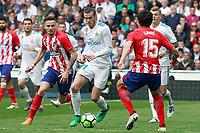 Real Madrid's Gareth Bale (c) and Atletico de Madrid's Saul Niguez (l) and Stefan Savic during La Liga match. April 8,2018. (ALTERPHOTOS/Acero)