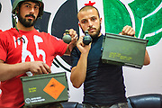 Two members of the Free Syrian Army (FSA) armed forces appear to hold and pose for a picture with a Swiss-made hand grenade in Marea on Sunday, July 1, 2012. The box holds the following ID numbers: 4A/Y21/S/03, CH/EGI-3932/RM, under title Grenades UN 0285. (Photo by Vudi Xhymshiti)