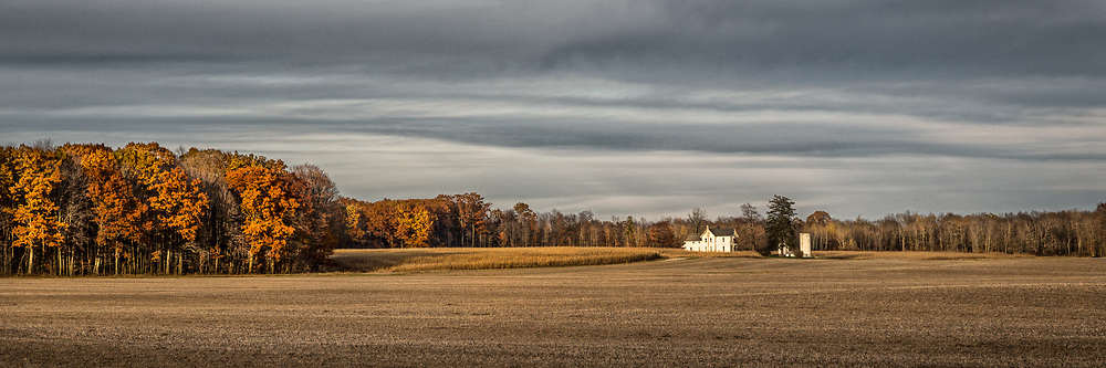 """An abandoned farm dots the horizen and is bathed in late afternoon sun in November.  Aspect ratio is 1""""w x .333""""h"""