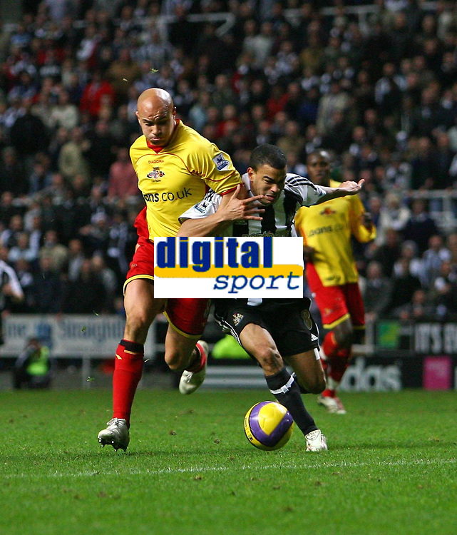 Photo: Andrew Unwin.<br /> Newcastle United v Watford. The Barclays Premiership. 16/12/2006.<br /> Watford's James Chambers (L) tussles with Newcastle's Kieron Dyer (R).