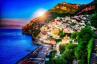 """""""Sunrise over Positano""""…<br /> <br /> There was only one occasion that I was able to pre-plan taking photos at sunrise and that was during the last day of three in Positano. It takes much planning, logistics, and familiarity to figure the best locations and the proper angles and positions of the sun. My third morning was ideal and fortuitous as it began raining about 10:00 am which offered perfect clouds for sunrise, finally ending with a very cold wind just in time for sunset. This image is one of the rare photos of a slumbering Positano in the dewing morning around 6:50 am at the end of May….the beginning of peak tourist season. By 8:00 am, this tiny seaside village is bustling with tourists and shop owners, and restaurateurs trying to satisfy every need. All in all, Positano was by far the plushest of all the locations I visited in Italy, and I was blessed to witness everything in full bloom. The primary focal point of Positano is the majestic view of the church of Santa Maria Assunta overlooking the picturesque seaside village. The radiant dome is composed of majolica tiles which are very prominent on the Amalfi Coast. This prominent and resplendent church contains a thirteenth-century Byzantine icon of the legendary Black Madonna. Photogenic is an understatement for Positano, as she poses to perfection graciously revealing le sue bellissime coste!"""