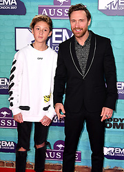 David Guetta and his son Tim Elvis Eric arriving at the MTV Europe Music Awards 2017 held at The SSE Arena, London. Photo credit should read: Doug Peters/EMPICS Entertainment