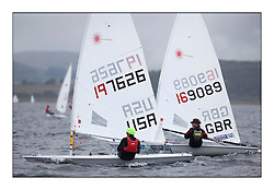 The second day of racing at the World Laser Radial Youth Championships, Largs, Scotland..Mitchell Kiss USA 197626 and Alexander Alcock GBR 169089..317 Youth Sailors from 42 different nations compete in the World and European Laser Radial Youth Champiponship from the 17-25 July 2010...The Laser Radial World Championships take place every year. This is the first time they have been held in Scotland and are part of the initiaitve to bring key world class events to Britain in the lead up to the 2012 Olympic Games. ..The Laser is the world's most popular singlehanded sailing dinghy and is sailed and raced worldwide. ..Further media information from .laserworlds@gmail.com.event press officer mobile +44 7866 571932 and +44 1475 675129 .