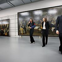 Nederland, Amsterdam , 12 februari 2014.<br /> Gallery of the Golden Age.<br /> Vandaag werd bekend dat drie musea in Amsterdam samen de Gallery of the Golden Age beginnen: een vaste tentoonstelling van meer dan 30 enorme groepsportretten 17e en 18e eeuw.<br /> Deze 'klasgenoten van de Nachtwacht' worden vanwege hun enorme omvang zelden tentoongesteld, maar in het 17e-eeuwse gebouw van de Hermitage is er ruimte voor. De tentoonstelling zal er vanaf eind november te zien zijn, maar bekijk hier alvast een selectie met onder meer de 'Anatomische les van dr. Deijman' van Rembrandt en schuttersportretten van Govert Flinck en Nicolaes Pickenoy.<br /> De zg Schuttersstukken opgeslagen in het depot van Amsterdam Museum, die tentoon gespreid zullen worden in de Hermitage<br /> Op de foto v.r.n.l. Paul Spies, directeur Amsterdam Museum, Cathelijne Broers. directeur Hermitage Amsterdam en Martine Gosselink, Hoofd afdeling Geschiedenis van het Rijksmuseum<br /> Foto:Jean-Pierre Jans