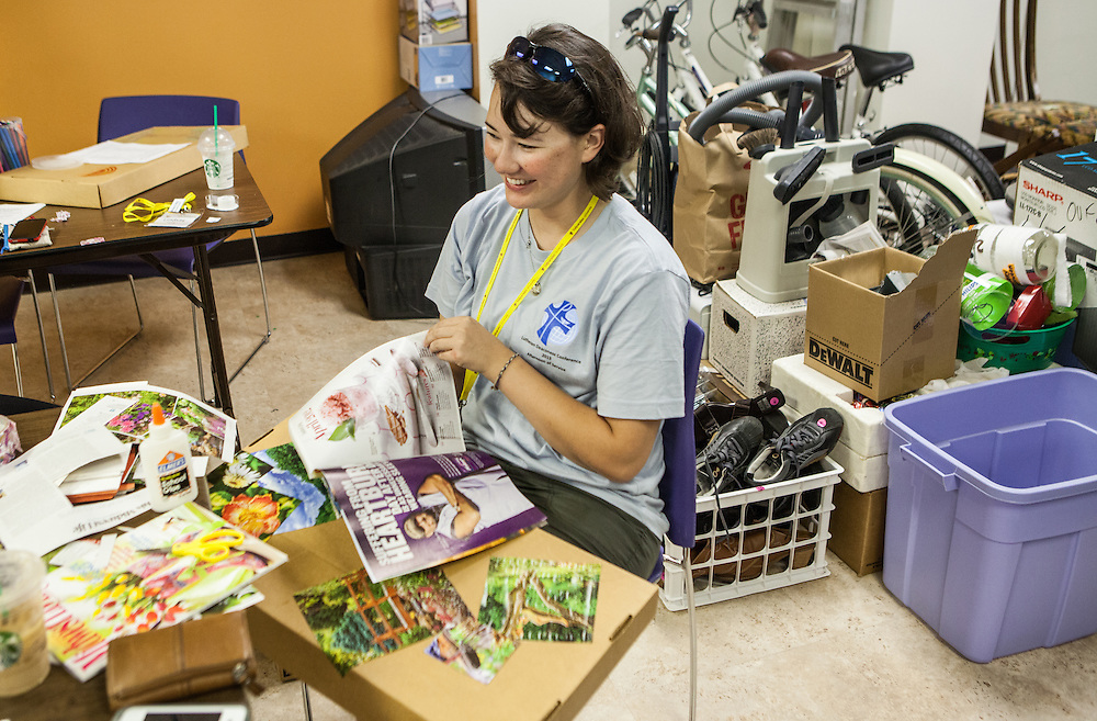 Sarah Johnson '11 of the Lutheran Deaconess Association help decorate collection boxes for Dayspring Women's Center in Valpariaso, IN. (Jeff Lange)