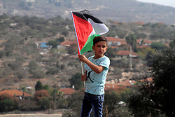 November 11, 2016 - Nablus, West Bank, Palestine - Palestinian protesters wave the national flag and carry posters of Palestinian leader Yasser Arafat, during a demonstration to mark the 12th anniversary of the former leader's death, on November 11, 2016 in the village of Kfar Qaddum, near Nablus, in the occupied West Bank. (Credit Image: © Mohammed Turabi/ImagesLive via ZUMA Wire)