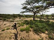 Moloba, a young Hadza man running. At and near the Hadza camp of Dedauko.