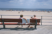Elderly couple relaxing at the beach