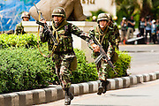 May 19 - BANGKOK, THAILAND: Thai soldiers run up Ratchadamri Road next to  Lumpini Park during the Thai government crack down against Red Shirt and anti government protesters. The Royal Thai Army attacked anti-government protesters May 19 with troops and armored personnel carriers. Photo by Jack Kurtz