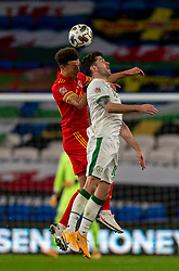CARDIFF, WALES - Sunday, November 15, 2020: Wales' Ethan Ampadu (L) and Republic of Ireland's Robbie Brady during the UEFA Nations League Group Stage League B Group 4 match between Wales and Republic of Ireland at the Cardiff City Stadium. Wales won 1-0. (Pic by David Rawcliffe/Propaganda)