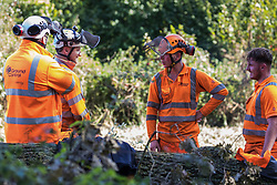 Denham, UK. 29th September, 2020. Tree surgeons working on behalf of HS2 Ltd take a break between felling trees in Denham Country Park for works connected to the HS2 high-speed rail link. Anti-HS2 activists based at the nearby Denham Ford Protection Camp and protesting against the destruction of the woodland contend that the area of Denham Country Park currently being felled is not indicated for felling on documentation supplied by HS2 Ltd.