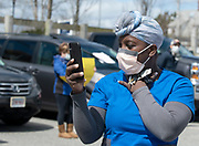 HYANNIS - A healthcare worker appears moved as she shoots video of the well-wishers in the Cape Cod Hospital parking lot on Friday, April 10, 2020.