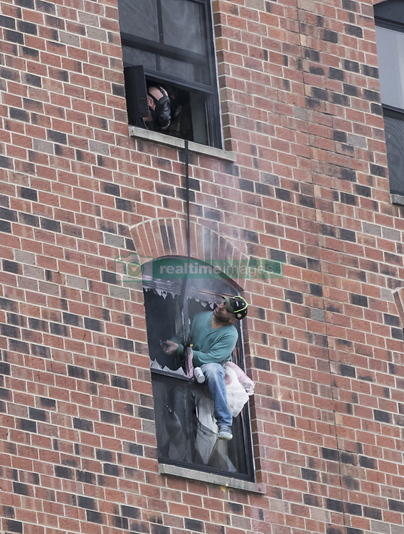 January 30, 2018 - Minneapolis, Minnesota, U.S.- A man leaned out a window and spoke with an officer in the room above as police try to negotiate with him to surrender a stand off with police that went on for 38 hours on Tuesday,  at the Graduate Hotel at the University of Minnesota. The two-day standoff ended when police arrested the man who had holed up in a sixth-floor room while grieving for his daughter and sending angry messages alleging someone had stolen his exotic cat. (Credit Image: © Renee Jones Schneider/Minneapolis Star Tribune via ZUMA Wire)