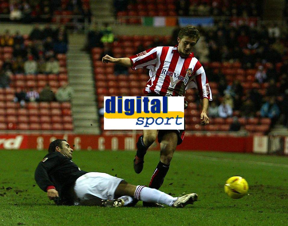 Photo. Andrew Unwin.<br /> Sunderland v Rotherham, Coca-Cola Championship, Stadium of Light, Sunderland 22/02/2005.<br /> Sunderland's George McCartney (R) tries to evade a sliding challenge from Rotherham's Paulo Vernazza (L).