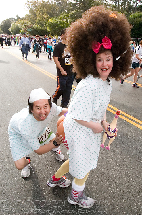 """""""Hospital patients"""" Joe and Nathalie Bugay of Monterey, Calif. clown for the camera during the 100th running of the Bay to Breakers 12K, Sunday, May 15, 2011 in San Francisco. (Photo by D. Ross Cameron)"""