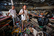 Brothers and employees, Chris Hall and Mark Hall ,enter the destroyed Part City Auto Parts,  to retrieve items for the owner in an area called The Mud in Abaco, Bahamas on Thursday, September 5, 2019