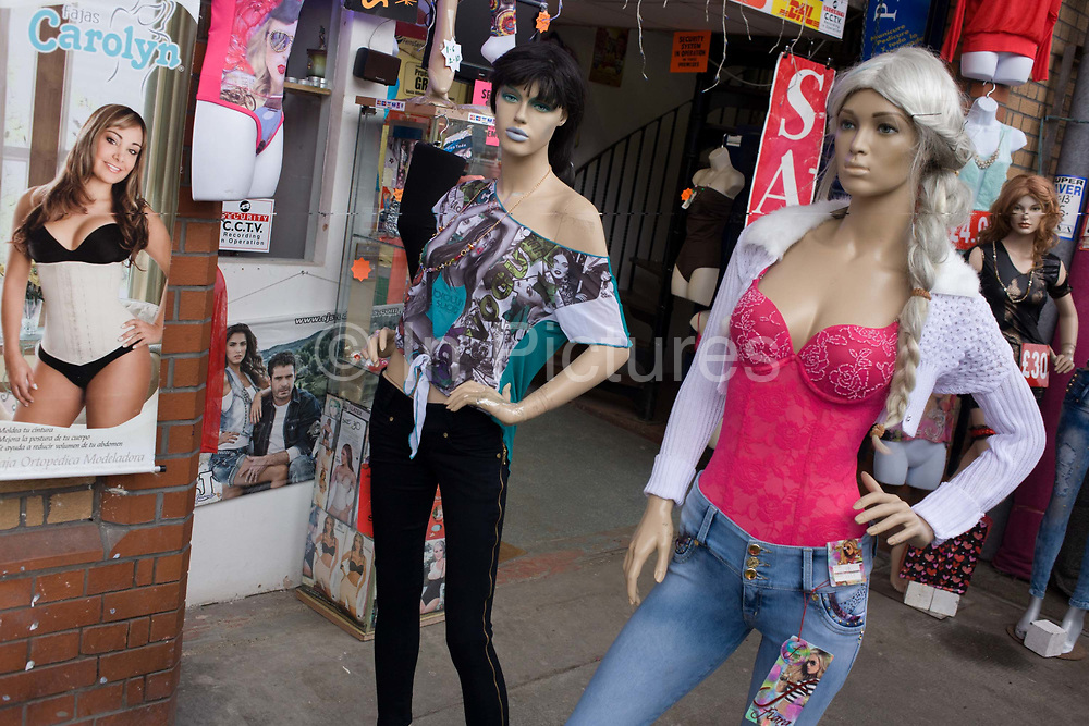 Mannequins of women show a sexist stereotype of their gender, outside a clothing business in south London. High street styles and fashions are on display here, showing a sexist representation of how women might appear. As proof of how the fashion and retail industries see the perfect woman's form, we see a skinnier look, the proportions of a curvy rather than a rounded female shape. Womens' groups however see this as unrepresentative, undermining how women see themselves portrayed accurately in the shop window and therefore in everyday life.