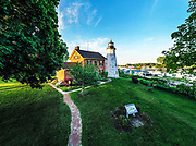 The 40 ft tower of the Charlotte Genesee Lighthouse looks over where the Genesee River meets Lake Ontario. The Charlotte Genesee Lighthouse is an 1822 stone octagonal lighthouse in the Charlotte neighborhood in northern Rochester, New York, United States.