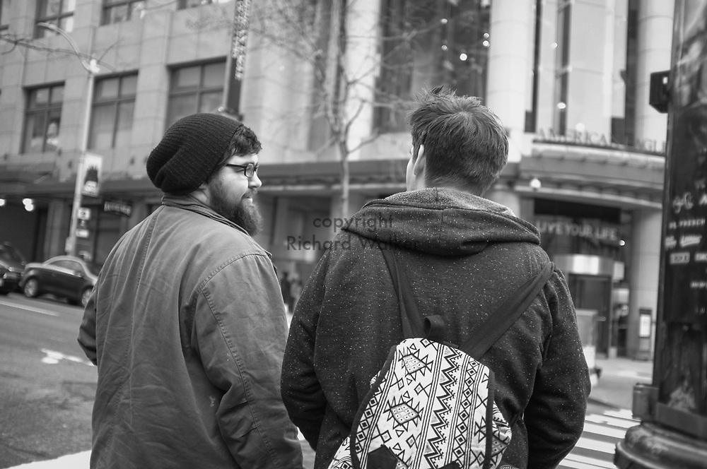2017 MARCH 05 - Two men on Pine St near Emerald City Comicon, downtown, Seattle, WA, USA. By Richard Walker