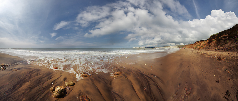 A wide-angle panoramic view of the beach at Compton Bay looking towards Freshwater.  Shot from a low point of view the image embraces the wide-angle distortion rather than attempting to correct it and attempt photo-realism.<br /> <br /> Ten shot 10mm panorama at f4.0 1/1250<br /> <br /> <br /> Part of the Ocean Seen - Oceanic Photography Exhibition.<br /> <br /> Sponsored by Wightlink - Dimbola Museum & Galleries, Freshwater Bay, Isle of Wight - 29th June to 2nd September 2012.<br /> <br /> A collaborative summer show, bringing together three great oceanic photographers to celebrate the way we interact with our great British coastline.
