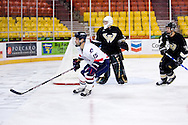 October 13, 2007 - Anchorage, Alaska: Brett Hopfe (15) of the Robert Morris Colonials goes after the puck in the 4-1 win over Wayne State at the Nye Frontier Classic at the Sullivan Arena.