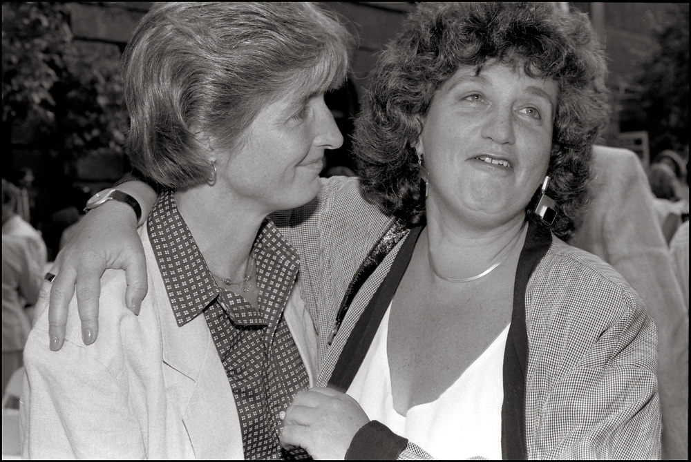 """Lee Hudson and Joan Nestle at The Gay & Lesbian Community Center's Garden Party. The Lesbian Herstory Archives opened for """"community use"""" in 1976 in Joan Nestle's apartment (an apartment she shared with  Lee Hudson) on Manhattan's Upper West Side, and remained there until it reopened in 1992 in a Brooklyn town house."""