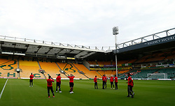 Charlton Athletic's players inspect the pitch prior to the match