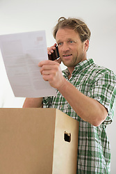 Document holding talking on the phone man