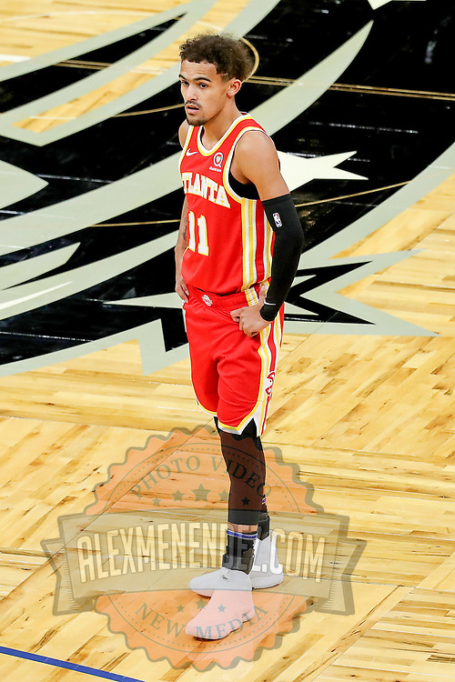 ORLANDO, FL - MARCH 03: Trae Young #11 of the Atlanta Hawks is seen in a game against the Orlando Magic at Amway Center on March 3, 2021 in Orlando, Florida. NOTE TO USER: User expressly acknowledges and agrees that, by downloading and or using this photograph, User is consenting to the terms and conditions of the Getty Images License Agreement. (Photo by Alex Menendez/Getty Images)*** Local Caption *** Trae Young