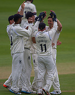 Chris Woakes(Warwickshire County Cricket Club) celebrates with team mates after taking the wicket of Paul Collingwood  (Durham County Cricket Club) during the LV County Championship Div 1 match between Durham County Cricket Club and Warwickshire County Cricket Club at the Emirates Durham ICG Ground, Chester-le-Street, United Kingdom on 14 July 2015. Photo by George Ledger.