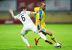 Srnic Dragoljub of FK Cukaricki vs Morel Benjamin of NK Domzale during 1st Leg football match between NK Domzale (SLO) na FC Cukaricki (SRB) in 1st Round of Europe League 2015/2016 Qualifications, on July 2, 2015 in Sports park Domzale,  Slovenia. Photo by Vid Ponikvar / Sportida