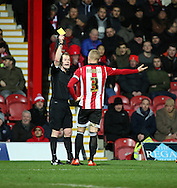 Brentford defender Jake Bidwell yellow card during the Sky Bet Championship match between Brentford and Middlesbrough at Griffin Park, London, England on 12 January 2016. Photo by Matthew Redman.