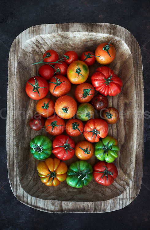 Tomatoes mix in a wood tray shoot from above.<br /> EXCLUSIVE ONLY ON THIS SITE!