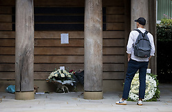 © Licensed to London News Pictures. 11/09/2021. London, UK. A member of the public looks at flowers flowers left at a memorial in Grosvenor Square in London on the 20th anniversary of the 9/11 terrorist attack. The attacks, which killed a total of 2,977 people, saw passenger jets seized by suicide attackers, flown into the Twin Towers of the World Trade Center in New York and the The Pentagon building. Photo credit: Ben Cawthra/LNP