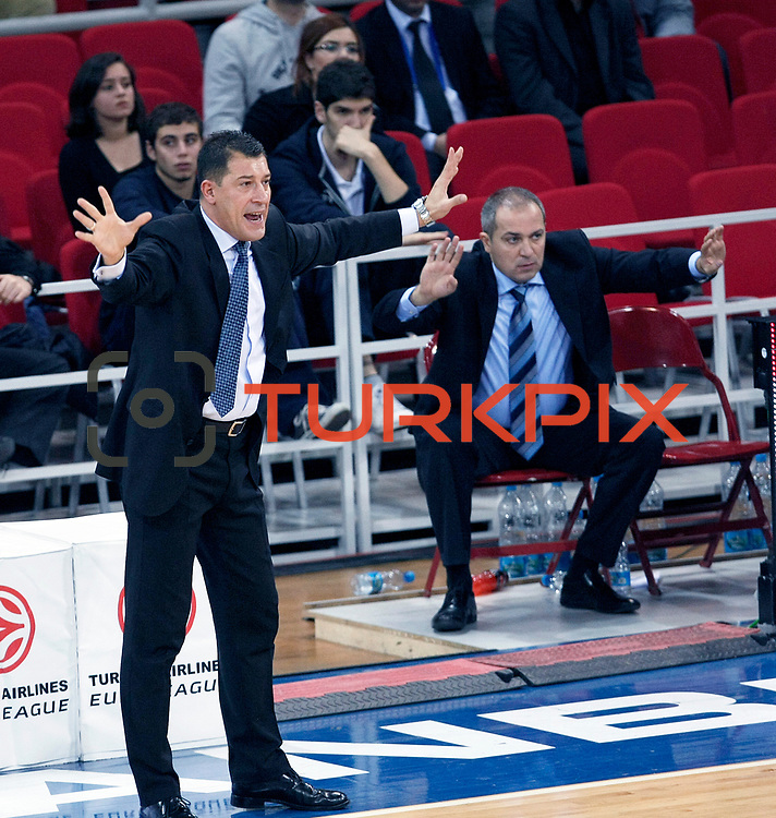 Anadolu Efes's coach Ufuk SARICA (L) during their Turkish Airlines Euroleague Basketball Group C Game 2 match Anadolu Efes between Belgacom Spirou  at Abdi Ipekci Arena in Istanbul, Turkey, Wednesday, October 26, 2011. Photo by TURKPIX