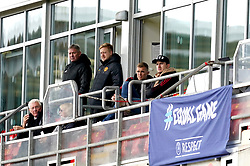 Manchester United's Harry Maguire (right) watches from the stands during the UEFA Youth League, Group F match at Leigh Sports Village, Manchester. Picture date: Wednesday September 29, 2021.