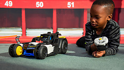 "© Licensed to London News Pictures. 13/11/2019. LONDON, UK. Mofe (aged 6) plays with an Imaginext DC Super Friends Transforming Batmobile by Mattel at the preview of ""DreamToys"", the official toys and games Christmas Preview, held at St Mary's Church in Marylebone.  Recognised as the countdown to Christmas, the Toy Retailer's Association, an independent panel of leading UK toy retailers, have selected the definitive and most authoritative list of which toys will be the hottest property this Christmas.  Photo credit: Stephen Chung/LNP"