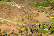 Aeriial photograph of a schoolbus on a rural Wisconsin road on a beautiful autumn day.