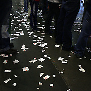 Betting slips on the floor at Belmont Park during the Jockey Club Gold Cup Day, Belmont Park, New York. USA. 28th September 2013. Photo Tim Clayton