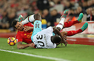 Michail Antonio of West Ham United and Dejan Lovren of Liverpool during the Premier League match at Anfield Stadium, Liverpool. Picture date: December 11th, 2016.Photo credit should read: Lynne Cameron/Sportimage