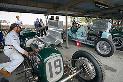 © Licensed to London News Pictures. <br /> 13/09/2019. <br /> Goodwood.West, Sussex. UK.<br /> The Goodwood Motor Circuit celebrates the 21st year of the Revival.This has become one of the biggest annual historic motorsport events in the world and the only one to be staged entirely in period dress. Each year over 150,000 people descend on this quiet corner of West Sussex to enjoy the three-day event.<br /> Pictured. A drivers and mechanics with their classic Frazer Nash racing cars.<br /> <br /> Photo credit: Ian Whittaker/LNP