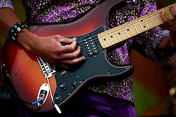 27 April 2013. New Orleans, Louisiana,  USA. .New Orleans Jazz and Heritage Festival. Guitar detail..Photo; Charlie Varley.