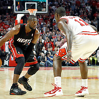 14 March 2012: Miami Heat shooting guard Dwyane Wade (3) dribbles against Chicago Bulls shooting guard Ronnie Brewer (11) during the Chicago Bulls 106-102 victory over the Miami Heat at the United Center, Chicago, Illinois, USA.