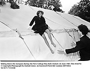 Sliding down the marquee during the New College May Ball. Oxford. 24 June 1983. film 83447f2<br />© Copyright Photograph by Dafydd Jones<br />66 Stockwell Park Rd. London SW9 0DA<br />Tel 0171 733 0108