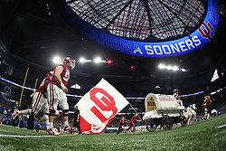 The Oklahoma Sooners run out on the field prior to the game against the LSU Tigers at the 2019 College Football Playoff Semifinal at the Chick-fil-A Peach Bowl on Saturday, Dec. 28, in Atlanta. (Jason Parkhurst via Abell Images for the Chick-fil-A Peach Bowl)
