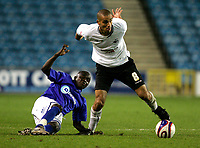 Photo: Tom Dulat/Sportsbeat Images.<br /> <br /> Millwall v Swansea City. Coca Cola League 1. 06/11/2007.<br /> <br /> Ali Fuseini of Millwall and Darren Pratley of Swansea City with the ball.