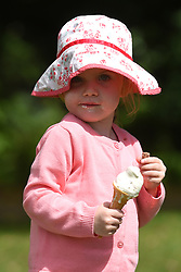 Sophie Forrest enjoys an ice cream on her third birthday in Stratford-upon-Avon as forecasters predict that a wave of warm air will move across the country in the coming days.