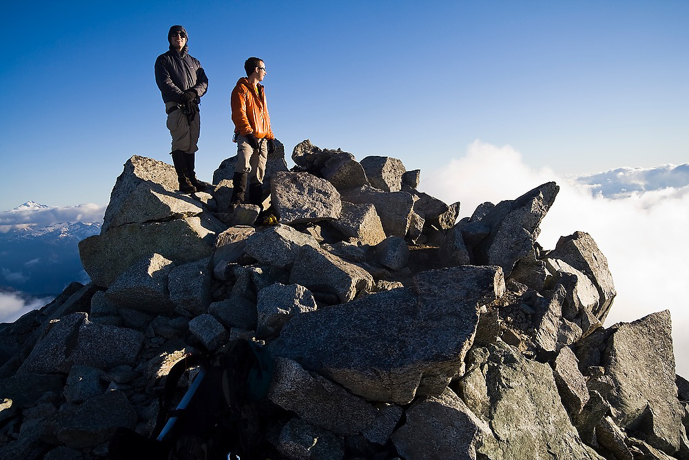 Brian Polagye and Jim Prager enjoy the views from the rocky summit of Eldorado Peak, a high peak in the heart of North Cascades National Park, Washington.
